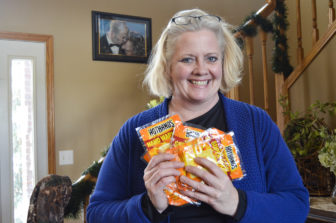 Shelle Aberle of Bismarck donates hand warmers to law enforcement.