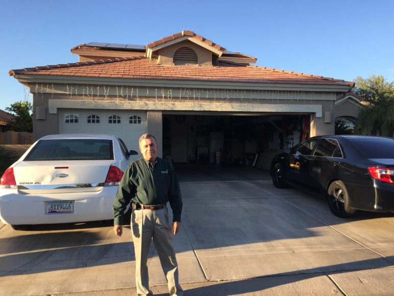 Charlie Miller stands in front of his home in the retirement community of Pebble Creek, west of Phoenix. Miller is one of the many republicans who have embraced solar in Arizona.