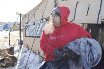 Dotty Agard of the Standing Rock Sioux Tribe helps sort through leftover items at camp.