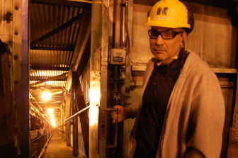 Sheldon Station Plant Manager Chris Cerveny shows the conveyor where coal is brought into the plant twice a day.