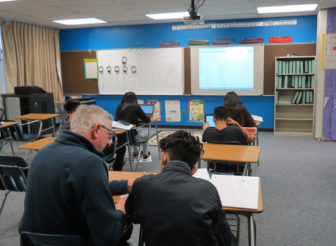 An eighth grade math classes at Covert Public Schools. The district has many low-income, minority students and has outperformed many districts in the state like it.