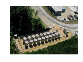 Palisades stores nuclear waste in these dry casks on the plant site, close to Lake Michigan.