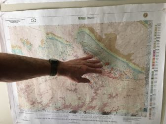 Tim Brown pointing out GFG Resource's work area out in the Rattlesnake Hills