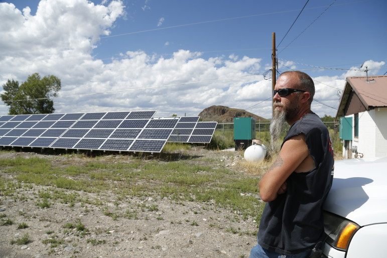 In Del Norte, CO, the Public Works Supervisor Kevin Larimore shows off an array of solar panels that provide electricity for the town's water supply.
