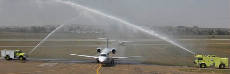 The first direct United Airlines flight from Houston to Williston lands with watery fanfare on Tuesday