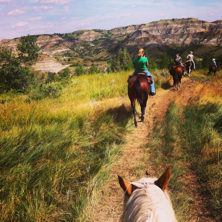 Horseback riding in the Badlands. Little Missouri State Park, North Dakota.