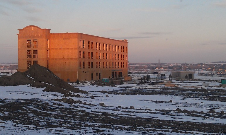 New hotels and apartments to accommodate boomtown visitors and workers are popping up on former farmland around North Dakota. This one is in Bismarck.