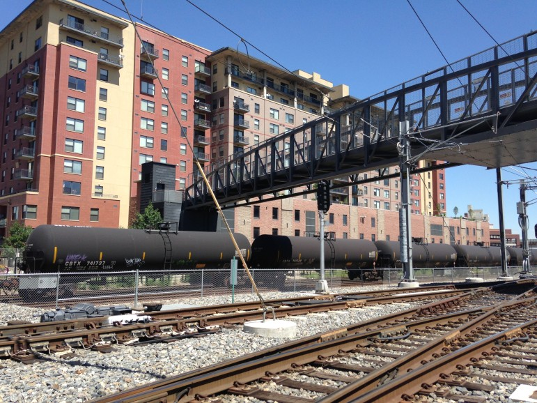 Crude oil tankers sit on the track in Denver's Lodo neighborhood.