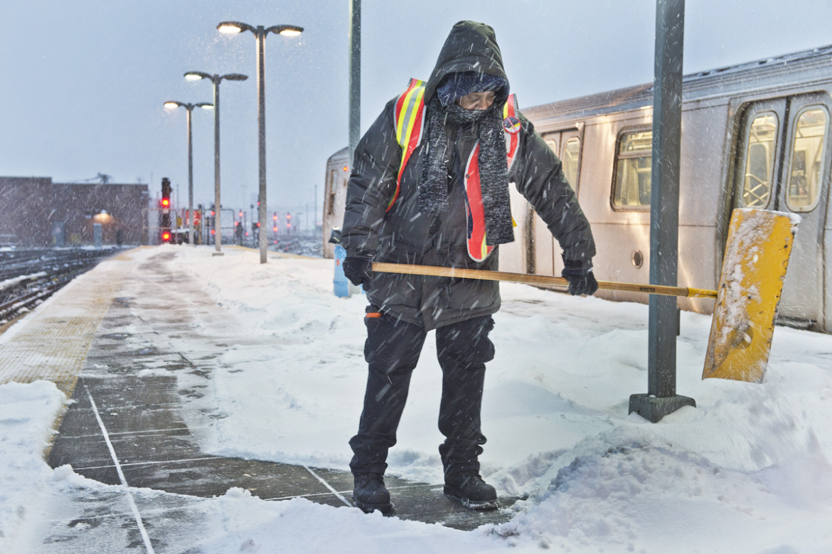 Transit worker clears snow off subway platform during the storm that hit the New York City area on January 21, 2014.