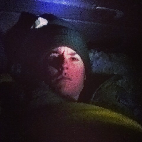 Getting ready to go to sleep in the back seat of my Honda Civic during gale-force winds in North Dakota.