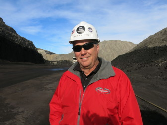 "Brian Wenig, one of the lead engineers at the Cordero Rojo Mine proudly wears a ""coal, guns, freedom"" sticker on his hard hat."