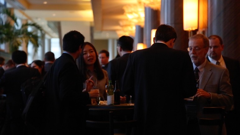 CERAWeek attendees network during one of the event's nightly cocktail parties.