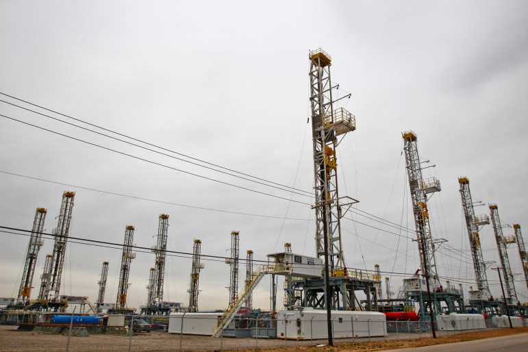 The growing number of oil rigs pulled in from the oilfield and stored in this lot in Odessa, Texas is a testament to the steep decline in the price of crude oil in the last year.