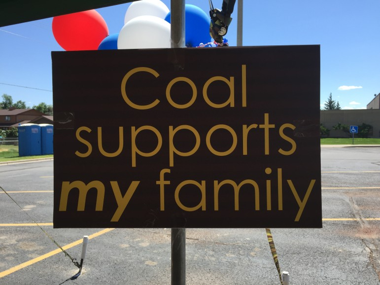 """A sign hanging at the """"Stop New Energy Taxes"""" rally."""