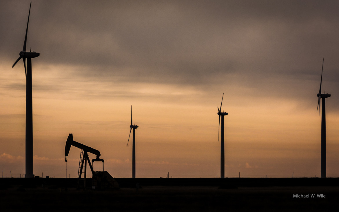 Wind turbines and an oil well outside Sweetwater, Texas.