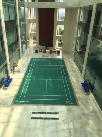 The shiny white lobby of a coal-fired power plant, owned by Shanxi International Group, is home to a badminton court and goldfish pond.