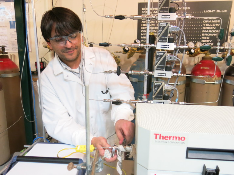 Chemical engineering student Anthony Richard experiments with converting CO2 into Methanol.