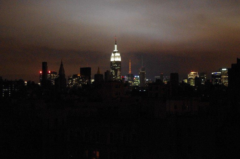 Midtown New York skyline with the Empire State Building in the background (with electricity), in the foreground is Alphabet City and the East Village without power, Tuesday night, November 30, 2012, after Hurricane Sandy.