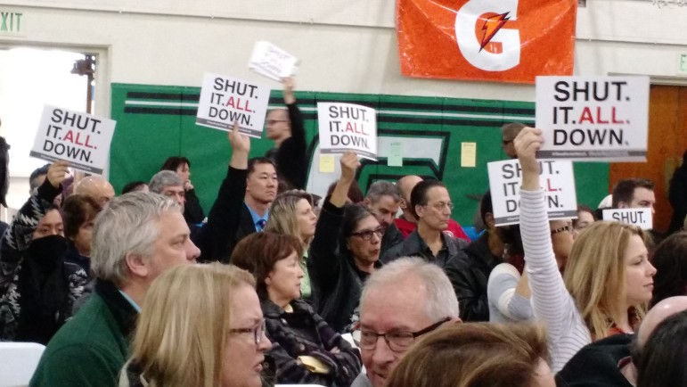 Signs like these asking for the complete closure of the Aliso Canyon Gas Storage facility, which Southern California Gas considers an essential asset, are beginning to appear at rallies held by residents of Porter Ranch.