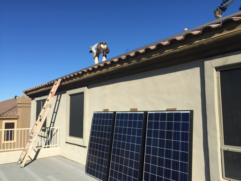 A crew from the Arizona-based solar installer, SunHarvest Solar, put up solar panels on a residence in Scottsdale, Arizona.