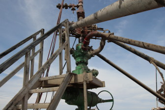 A wellhead near Stanton, Texas. The rig count in the Permian Basin has fallen by 50 per cent since April 2014. But production is rising.