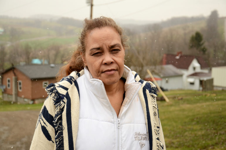 Jeannie Moten lives down the street from the Eakins. She has no running water at her home, and receives drinking- water donations, as do several of her neighbors.