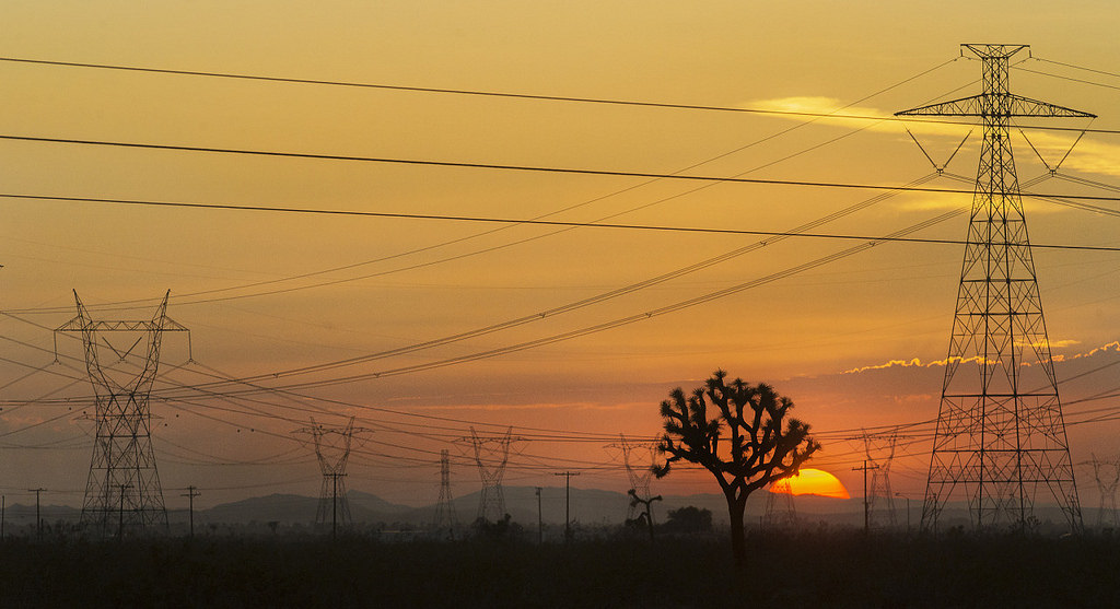Transmission lines criss-cross the landscape in Adelanto, California. Image via Flickr user jose|huerta shared with a Creative Commons license.