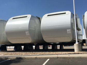 Nacelles, manufactured by Vestas, lined up outside of the company's Brighton, CO facility.