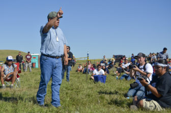 Standing Rock historic preservation officer Jon Eagle Sr. addresses a crowd of protesters gathered at a camp near the Dakota Access Pipeline construction site along the Missouri River.