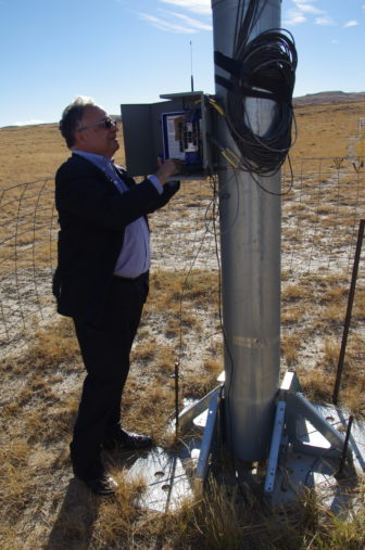 Viridis Eolia CEO Juan Carlos Carpio checks the wind speed at the company's project site in the Shirley Basin of Wyoming.